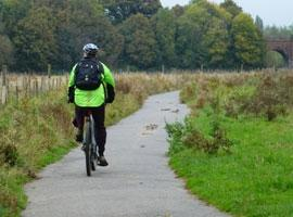 visitor cycling on the great stour way in canterbury
